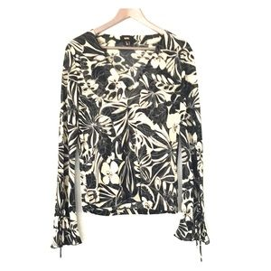 Sheer flowered blouse with charming bell sleeves